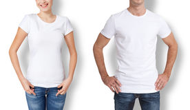 Shirt design and people concept - close up of young man and woman in blank white t-shirt . Shirt design and people concept - close up of young man and woman in royalty free stock images