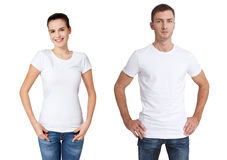Shirt design and people concept - close up of young man and woman in blank white t-shirt isolated. stock photos