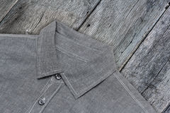 Shirt gift clipping paths wood background. Gray shirt put on the table Royalty Free Stock Images