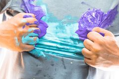 Shirt and hand dirty with paint in a superhero pose stock photography