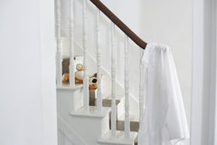 Shirt Hanging On Banisters. White shirt hanging on banisters with soft toy on steps Stock Image