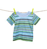 Shirt hanging on the clothesline on white Royalty Free Stock Image