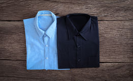 Shirt and Jeans shirt on wooden background Stock Image