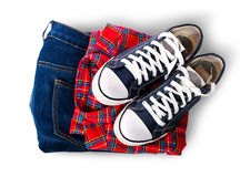 Shirt jeans and sports shoes Stock Image