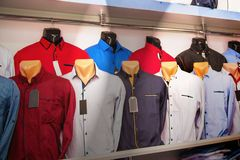 Shirt on mannequins in  men`s clothing store. Stylish clothes fo. R sale Stock Photo