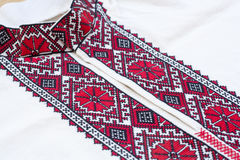 Shirt with national Ukrainian embroidered red and black colors Stock Photos