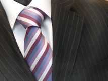 Shirt - necktie - suit. White shirt with striped necktie & business suit Royalty Free Stock Photos