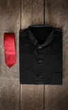 Shirt and neckties on wooden background Royalty Free Stock Images