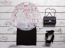 Shirt with print and purse. Royalty Free Stock Images