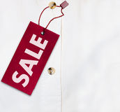 Shirt With Sale Tag Stock Photos