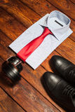 Shirt, shoes and belt on a wooden background Royalty Free Stock Photo