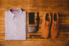 Shirt shoes glasses next to wallet and smartphone Stock Images