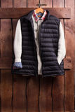 Shirt, sweater and vest on a wooden fence. Royalty Free Stock Photos