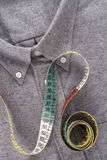 Shirt and tape measure Royalty Free Stock Photo