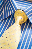 Shirt and tie. Blue shirt with stripes and yellow tie Stock Photo
