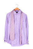 Shirt with tie. On wooden hanger isolated on white Royalty Free Stock Image