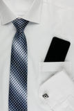 Shirt, tie, cuff links and a mobile phone Stock Image