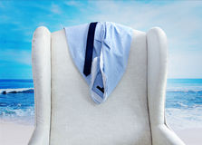 Shirt and tie hanging on a chair Royalty Free Stock Photography