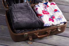 Shirt and trousers in the suitcase. Stock Photography
