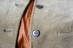 Shirt velvet and button. Old shirt brown velvet and two button Royalty Free Stock Photos