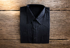 Shirt on wooden background Stock Images