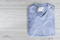 Shirt on wooden background Stock Photos