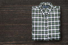 Shirt on wooden background Royalty Free Stock Image