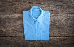 Shirt on wooden background Royalty Free Stock Photos