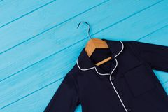 Shirt on wooden hanger Royalty Free Stock Images