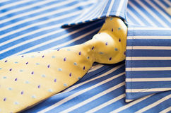 Shirt and yellow tie. Closeup of blue shirt with stripes and yellow tie Royalty Free Stock Image