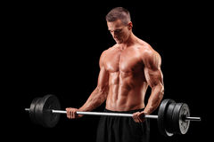 Shirtless athlete exercising with a barbell Stock Photo