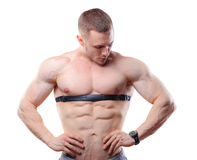 Shirtless athlete man posing with heart rate watch Royalty Free Stock Photography