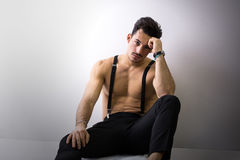 Shirtless athletic young man with suspenders Royalty Free Stock Photo