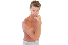 Shirtless attractive man flexing muscles Royalty Free Stock Images