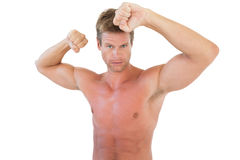 Shirtless attractive man showing his biceps Stock Photos