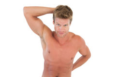 Shirtless attractive man showing his muscles Stock Photos