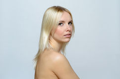 Shirtless Blond Young Woman Looking at the Camera Royalty Free Stock Photography
