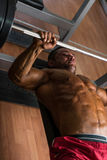 Shirtless body builder doing bench press for chest Royalty Free Stock Photography