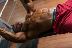 Shirtless bodybuilder doing bench press for chest Stock Photography