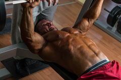 Shirtless bodybuilder doing bench press for chest Royalty Free Stock Photo