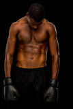 Shirtless boxer over black background Royalty Free Stock Photos