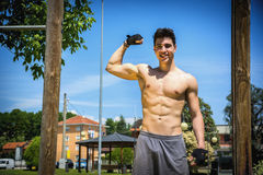 Free Shirtless Fit Athletic Young Man Doing Bicep Pose Royalty Free Stock Images - 54111389