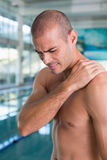 Shirtless fit swimmer by the pool at leisure center Stock Photo