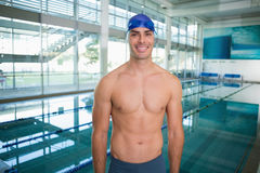Shirtless fit swimmer by pool at leisure center Royalty Free Stock Photo