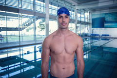 Shirtless fit swimmer by the pool at leisure center Stock Photos