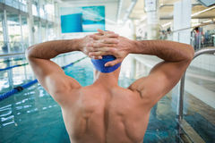 Shirtless fit swimmer by pool at leisure center Royalty Free Stock Photography