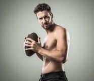 Shirtless football player Stock Photos