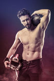 Shirtless football player with helmet. Attractive shirtless football player holding protective helmet and posing Stock Images