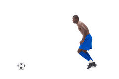 Shirtless football player moving to the ball Royalty Free Stock Photography