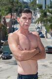 Shirtless guy on city street. Royalty Free Stock Photography